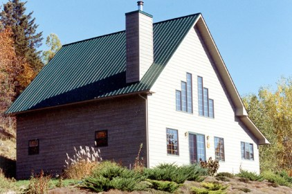 This cottage-like wooden home is topped off by a steel sheet roof from Metal Roof Outlet, Ontario.