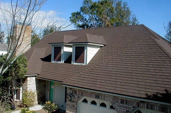 This Ontario home features a dark brown shingle-style roof from Metal Roof Outlet.