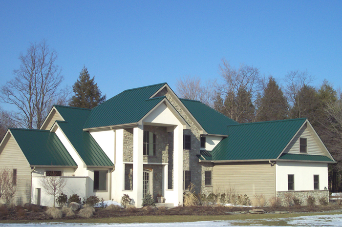 This two-story Ontario home features a beautiful green steel roof from Metal Roof Outlet.
