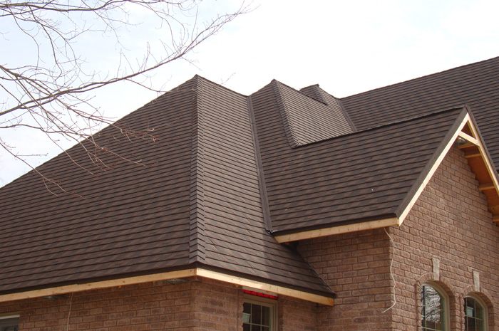 This lovely Ontario home almost looks like a gingerbread house - but we don't recommend you try to break a piece off this highly durable steel roof from Metal Roof Outlet.