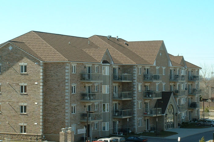 This four story condominium complex features a brown steel shake roof installed by Metal Roof Outlet, Ontario.