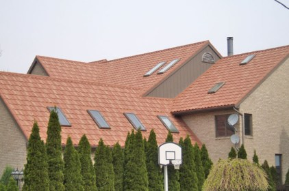 This Ontario home has a plethora of skylights - no problem for Metal Roof Outlet's professional and capable installation teams.