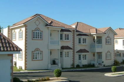 This cream coloured condominium finished their mediterranean look with a brown steel tile from Metal Roof Outlet.