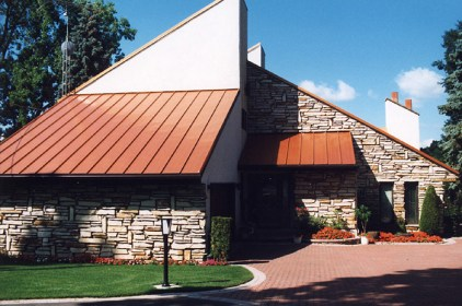 Metal Roof Outlet installed rust-coloured steel sheet roofing on an Ontario home