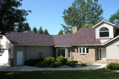 This Ontario house combines brick, siding, and a metal shake roof by Metal Roof Outlet.