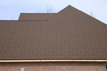 A chestnut coloured metal shingle roof installed on an Ontario home