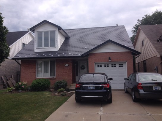 Some metal roofs have specailty finishes, but this Ontario metal roof foregoes the shingle or shake look in favour of a sleek & evidently metallic look.