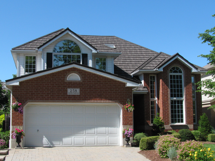 A two-story home featuring a steel shake roof from Metal Roof Outlet