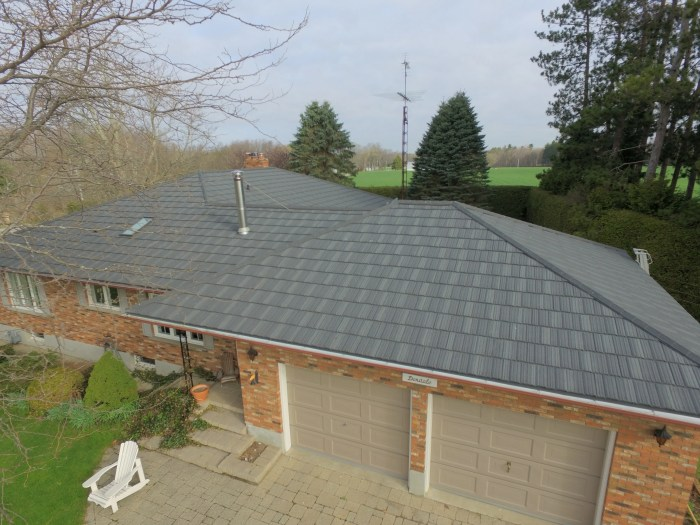 A weathered wood steel shake roof installed by Metal Roof Outlet