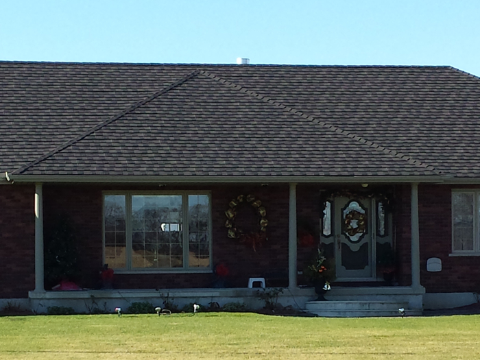 This single story Ontario home features a gorgeous Steel Granite Ridge Shingle in Heather Blend by Metal Roof Outlet.