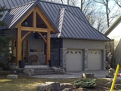 This Oakville home features a standing seam metal roof in the colour Maritime Grey.