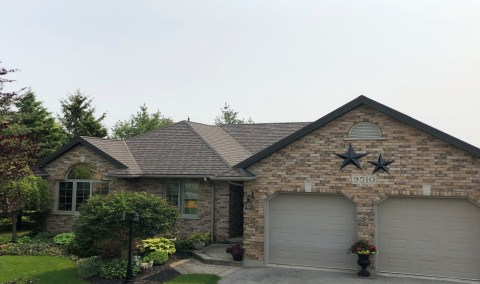 Metal shingle roofing in Timberwood colour from Metal Roof Outlet