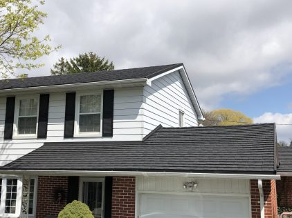 Charcoal coloured metal shingle roofing in Ontario