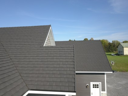 Metal Roof Outlet installed a Charcoal CF Shingle roof