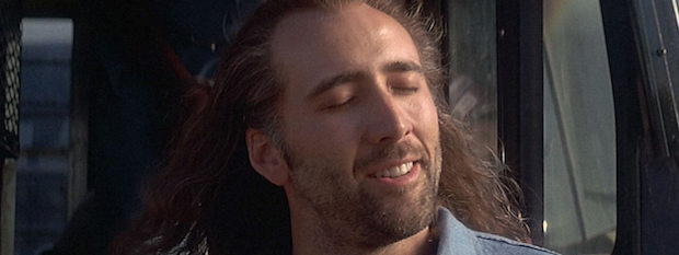 Nicolas Cage smiling and embracing the sunshine after 8 long years in prison for murdering a man. Con Air.