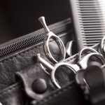 Closeup of toolbelt of hair stylist with scissors and comb