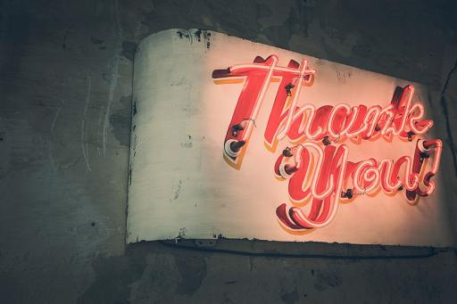 image of neon signs saying thank you for blog by Metis HR on employee rewards