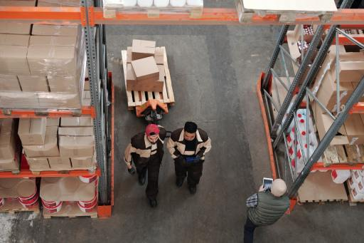 two people in a warehouse taken from above representing workplace inclusion for blog by Metis HR