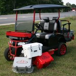 E-Z-GO RXV - Red and black with coolers and brush guard