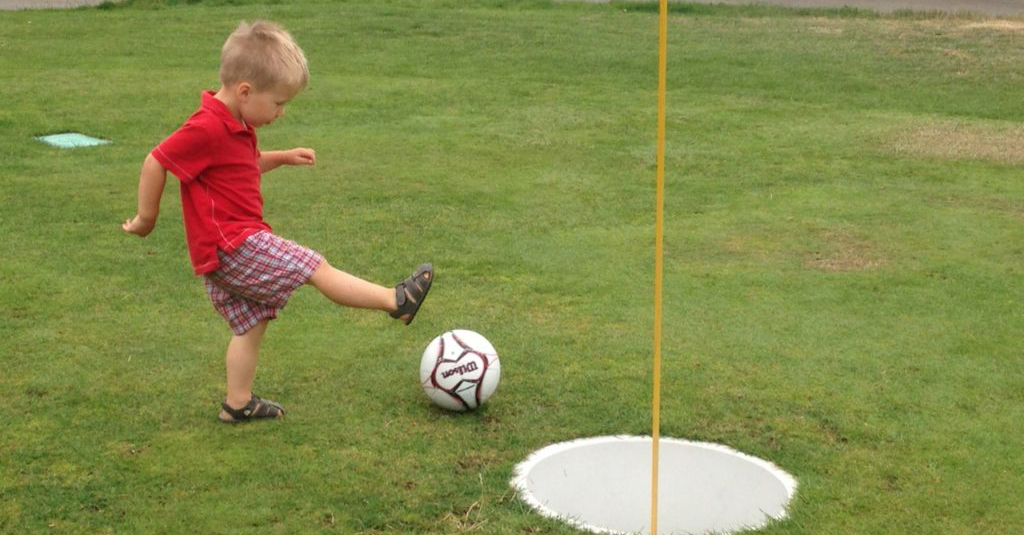 kid playing footgolf
