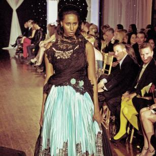 Design by Cory Couture shown at Next Fashion 2012 runway show at Germania Place during Fashion Focus Week Chicago. Model Saba Solomon.