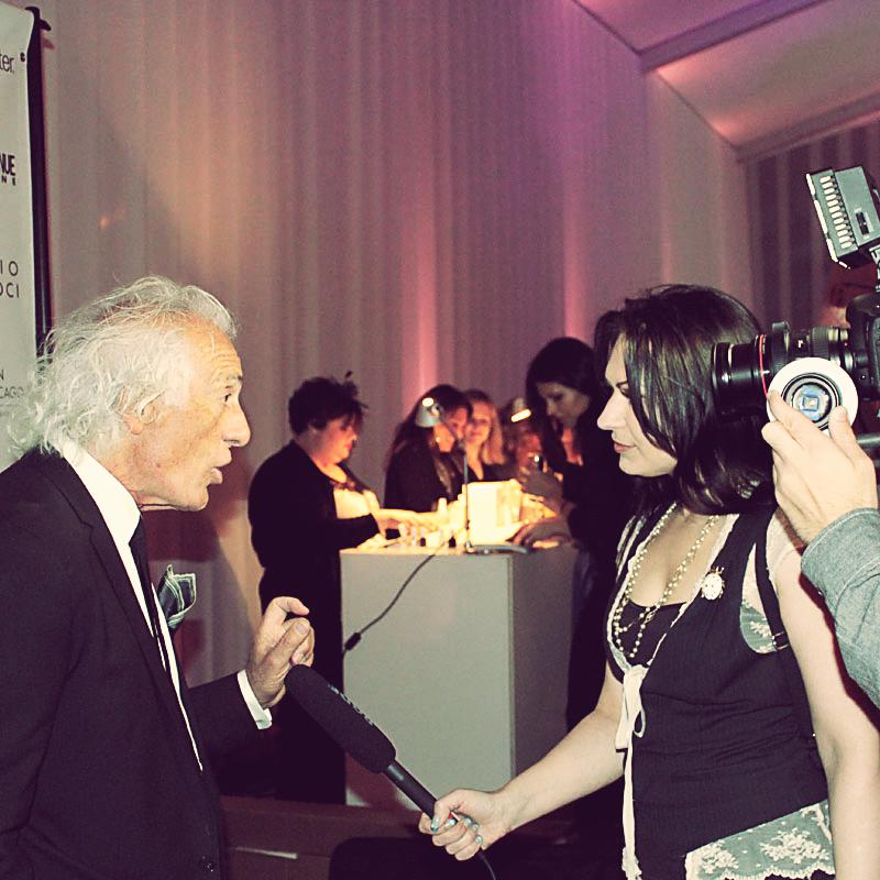 Raven Mai interviewing Mario Tricoci before the Fashion Takes Flight runway show.