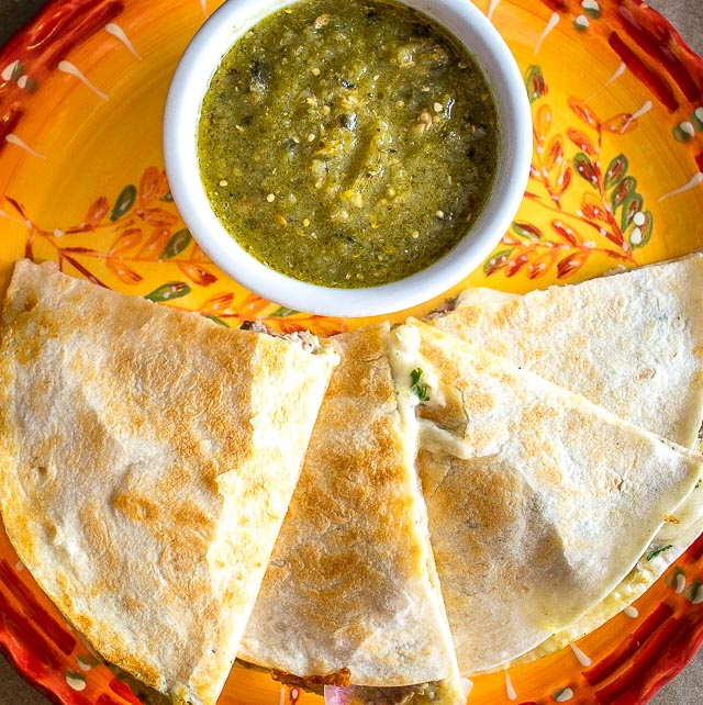 As promised, here are the quesadillas I've been making with my leftover Chili Verde. I used some homemade pickled onions for this batch and they are delicious! mexicanplease.com