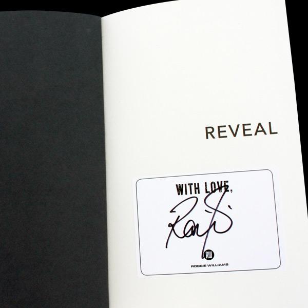 Robbie-Williams-Reveal-Signed-Copy-inside