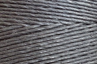 A spool of our black waxed cord.