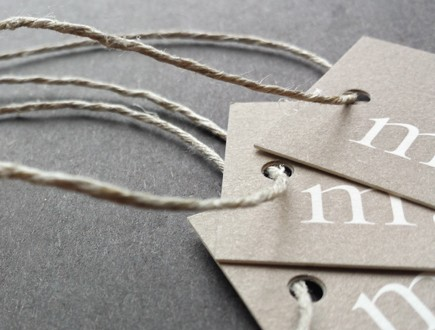 Tags on light brown tag stock strung with our 6-ply hemp.