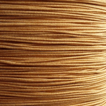 A spool of our gold non-fray elastic.
