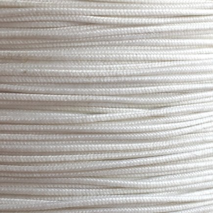 A spool of our white non-fray elastic.