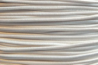 A close-up photograph of a spool of our #80 elastic in white.