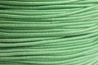 A spool of our rare light green non-fray elastic.