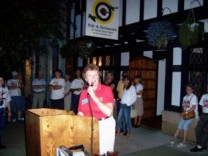 Margie Springer announcing the winners