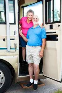 Seniors standing in doorway of RV