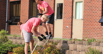 Will Hernandez and Braeden Svoboda, both '19, help to mulch the Starry flower bed.