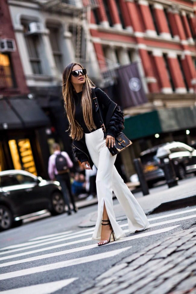 fashion blogger mia mia mine wearing white pants from revolve and manolo blahnik heels