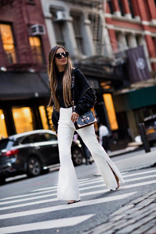 fashion blogger mia mia mine wearing a prada cahier bag from saks