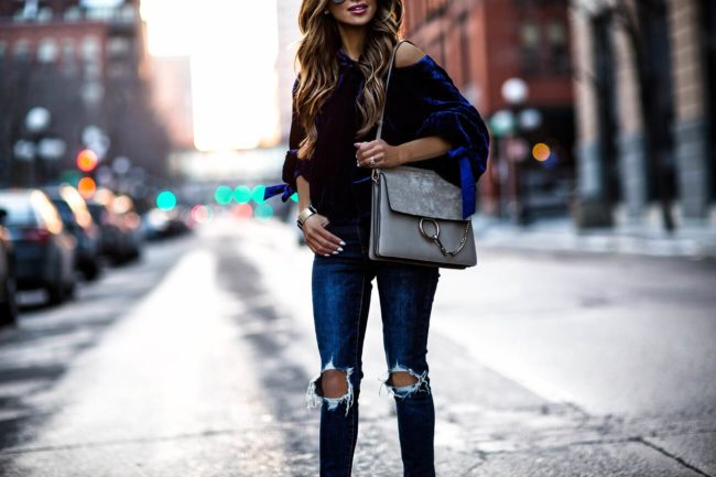 fashion blogger mia mia mine wearing levi's denim and a blue velvet top by free people