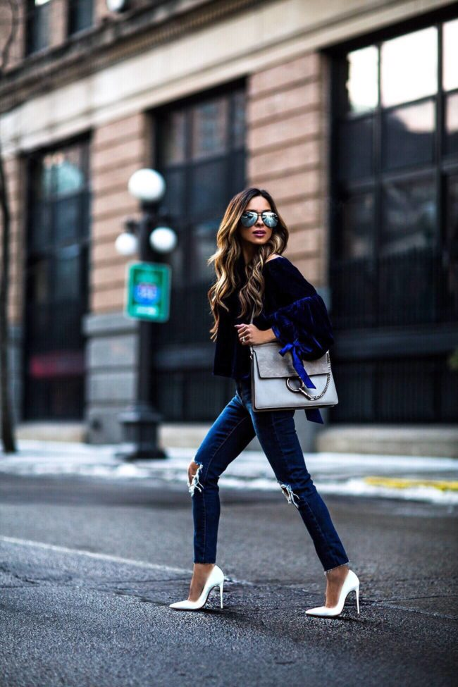 fashion blogger mia mia mine wearing a chloe faye bag and blue velvet top and chloe faye bag from nordstrom