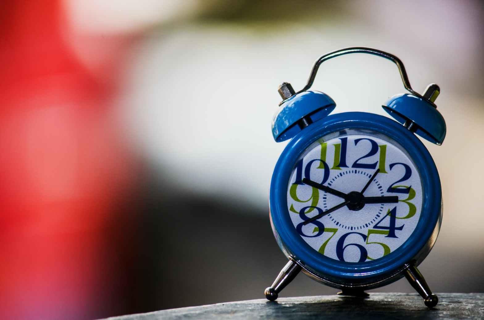 blue and white alarm clock