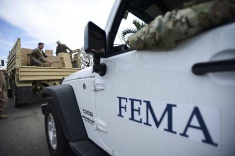 Department of Homeland Security personnel deliver supplies to Santa Ana residents in the aftermath of Hurricane Maria in Guayama, Puerto Rico.