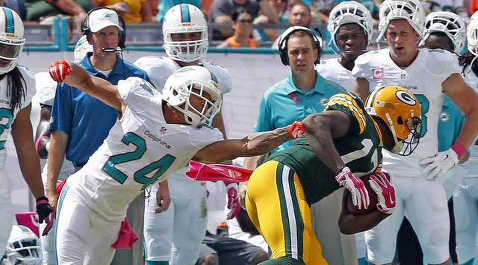 Davante Adams of the Green Bay Packers and Courtland Finnegan of the Miami Dolphins