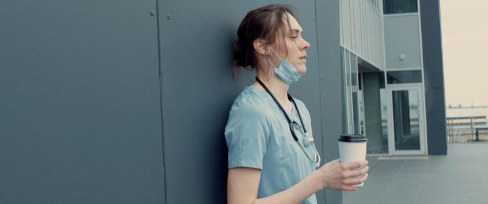 Portrait,Of,Tired,Exhausted,Nurse,Or,Doctor,Having,A,Coffee