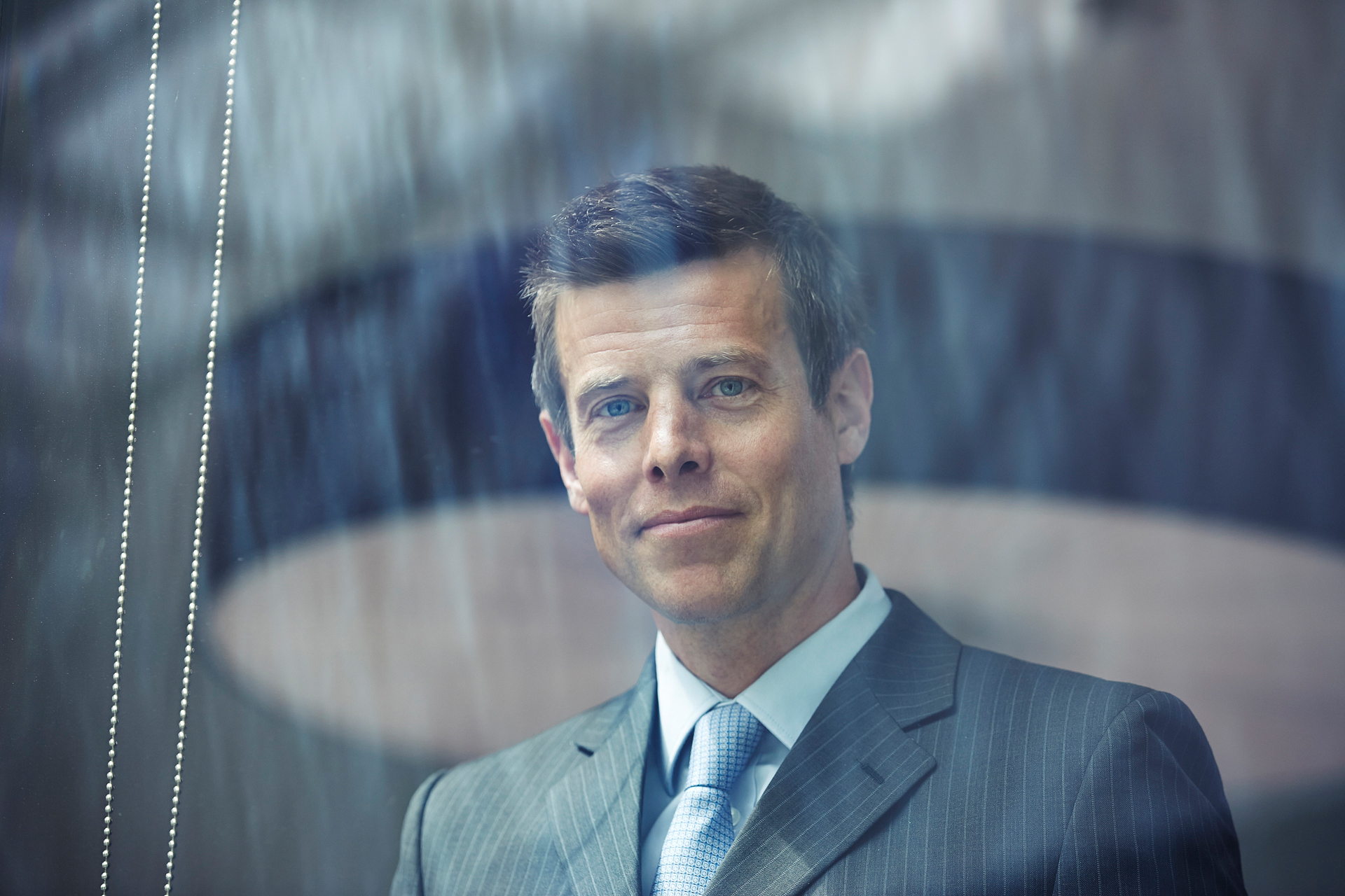 corporate photography portrait of business man smiling looking at camera