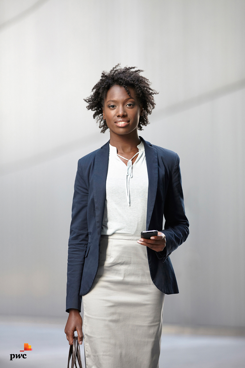 Business woman in city street smiling to camera, corporate photography portrait