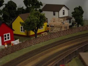 I always enjoyed this scene on the railroad. The garage in progress was scratch built. Pre ballast and weeds along the mainline.