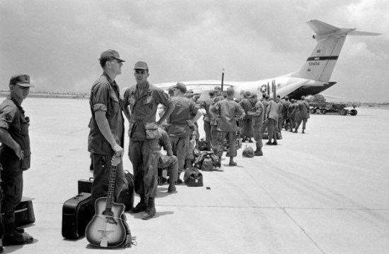 Some of the 300 troops of the 9th Infantry Division scheduled for departure from South Vietnam line up to board aircraft bound for Hawaii, August 27, 1969. (AP Photo)