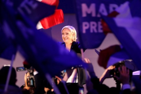 Marine Le Pen, French National Front (FN) political party leader and candidate for French 2017 presidential election, celebrates after early results in the first round of 2017 French presidential election, in Henin-Beaumont, France, April 23, 2017.    REUTERS/Charles Platiau     TPX IMAGES OF THE DAY - RTS13L2C
